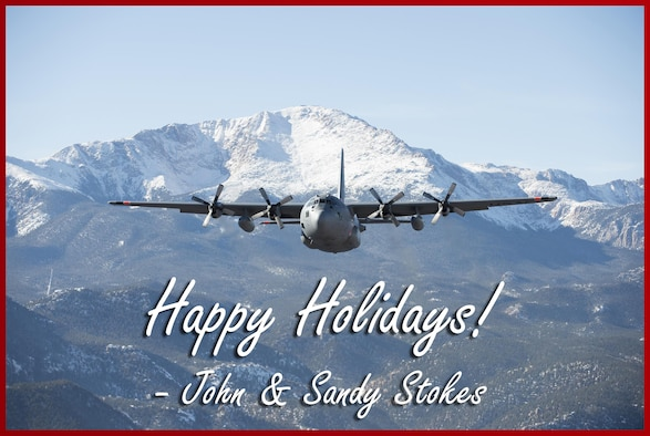 Maj. Gen. John Stokes, 22nd Air Force commander, would like to wish all 22nd AF Airmen a happy holiday season. Pictured is a C-130 from the 302nd Airlift Wing in front of Pikes Peak, Colorado Springs, Colo. during a local training mission, Dec. 19, 2014. (U.S. Air Force image/Senior Airman Spencer Kennedy and Staff Sgt. Alan Abernethy)