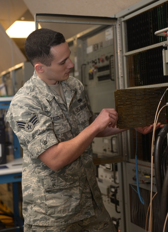 Senior Airman Dylan Slaughter, an avionics technician assigned to the 28th Maintenance Squadron, inserts a panel into a Radar Electronic Warfare (REW) station at Ellsworth Air Force Base, S.D., Dec. 6, 2016. The REW and the Defensive Avionics (DAV) stations are used to repair line replaceable units that affect aircraft systems such as radar, terrain following, counter measures and radios. (U.S. Air Force photo by Airman 1st Class Donald C. Knechtel)