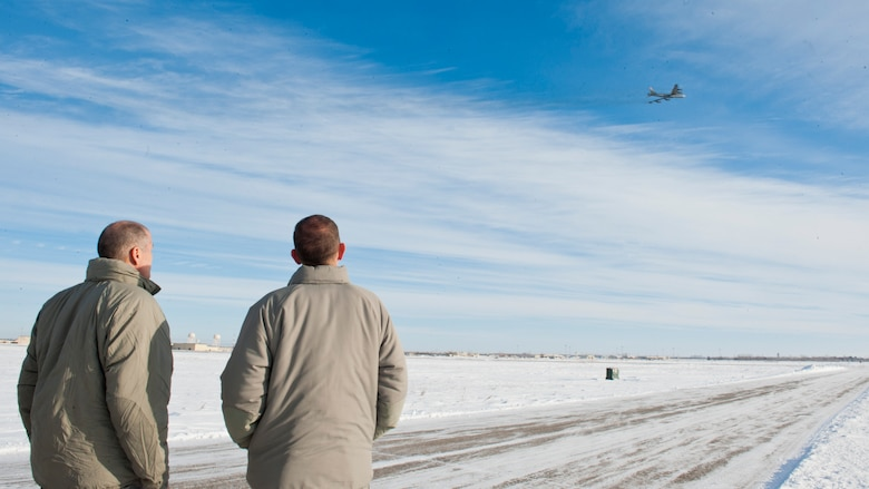 (From left) Maj. Gen. Thomas Bussiere, 8th Air Force commander, and Lt. Col. Drew Smith, 5th Operations Group deputy commander, watch a B-52 Stratofortress launch at Minot Air Force Base, N.D., Dec. 14, 2016. Bussiere toured Minot's facilities and spoke with 5th Bomb Wing Airmen. (U.S. Air Force photo/Airman 1st Class J.T. Armstrong)