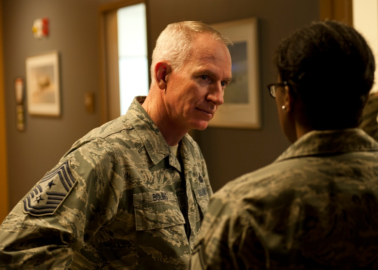 Chief Master Sgt. Alan Boling, 8th Air Force command chief, speaks with Senior Master Sgt. Odette Toppin, 5th Operations Group superintendent at Minot Air Force Base, N.D., Dec. 15, 2016. Boling toured Minot's facilities, including the air traffic control tower and spoke with 5th Bomb Wing Airmen. (U.S. Air Force photo/Airman 1st Class J.T. Armstrong)