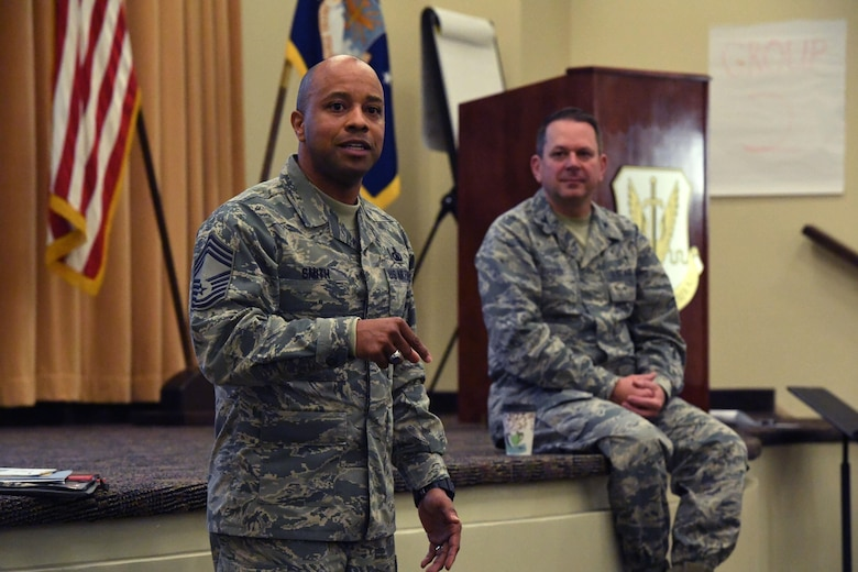 Chief Master Sgt. Antonio Smith, Air Combat Command chaplain assistant functional manager, speaks during an ACC Chaplain Corps Leadership Development Symposium Dec. 8, 2016. With an intent to allow chaplains to better serve the Air Force, Command chaplains and their chief chaplains' aids from three major commands – U.S. Air Force in Europe, Air Education and Training Command and Air Combat Command – collaborated at the symposium. (U.S. Air Force photo by Staff Sgt. Nick Wilson)