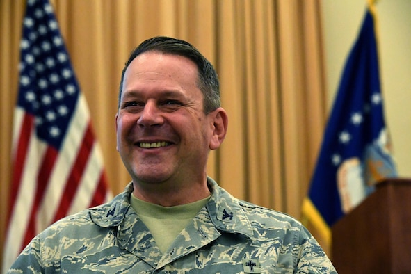 Chaplain (Col.) Timothy Butler, Air Combat Command Chaplain, smiles at an ACC Chaplain Corps Leadership Development Symposium Dec. 8, 2016. The symposium's intent was to bring senior chapel leadership together in a forum to discuss leadership strategies, share best practices and better leverage chapel resources. (U.S. Air Force photo by Staff Sgt. Nick Wilson)