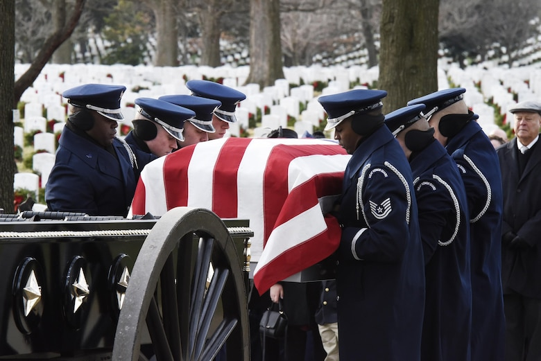 Members of the U.S. Air Force Honor Guard remove Maj. Troy Gilbert from a caisson during his interment at Arlington National Cemetery, Va., Dec. 19, 2016. Gilbert was killed Nov. 27, 2006, while flying a mission in direct support of coalition ground combat operations when his F-16C Fighting Falcon crashed approximately 20 miles northwest of Baghdad. (U.S. Air Force photo/Staff Sgt. Alyssa C. Gibson)