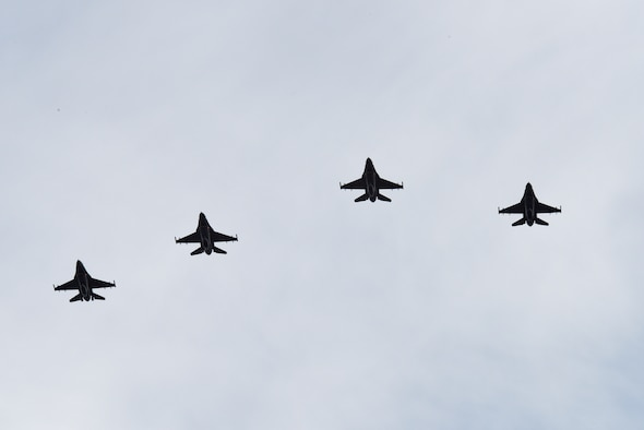 Four F-16 Fighting Falcons fly in formation over the funeral service for Maj. Troy Gilbert at Arlington National Cemetery, Va., Dec. 19, 2016. The aircraft are stationed at Luke Air Force Base, Ariz., which was Gilbert's home station at the time of his death. (U.S. Air Force photo/Staff Sgt. Alyssa C. Gibson)