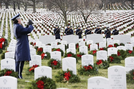 The U.S. Air Force Honor Guard performs a 21-gun salute during the interment of Maj. Troy Gilbert at Arlington National Cemetery, Va., Dec. 19, 2016. Gilbert's family and more than 300 friends, colleagues and wingmen attended the funeral to pay their respects and honor the fallen Airman. (U.S. Air Force photo/Staff Sgt. Jannelle McRae)