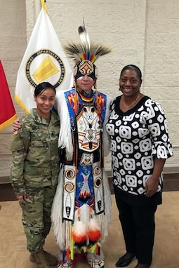 Lt. Col. Vickie Argueta, left, with Yolanda Owens, right, both assigned to the 85th Support Command Equal Opportunity Office, pause for a photo with a performer during a First Army Native American Heritage observance at Rock Island Arsenal.