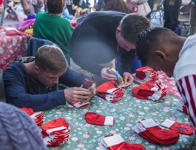 U.S. Marines with I Marine Expeditionary Force Headquarters Group design holiday stockings during the I MHG Holiday Party at Marine Corps Base Camp Pendleton, Calif., Dec. 14, 2016. The Marines and their family members celebrated the holiday season by building gingerbread houses, decorating stockings and designing Christmas ornaments while enjoying a holiday meal in camaraderie. (U.S. Marine Corps photo by Cpl. Alvin Pujols)