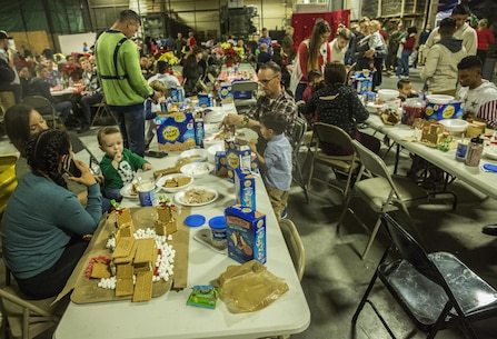 U.S. Marines and their family members  participate in the gingerbread house competition during the I Marine Expeditionary Force Headquarters Group Holiday Party at Marine Corps Base Camp Pendleton, Calif., Dec. 14, 2016. The Marines and their family members celebrated the holiday season by building gingerbread houses, decorating stockings and designing christmas ornaments while enjoying a holiday meal in camaraderie. (U.S. Marine Corps photo by Cpl. Alvin Pujols)