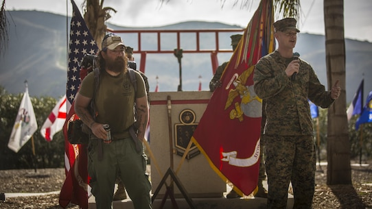 1st Sgt. Brian Holloway, the first sergeant for Company Fox, 2nd Battalion, 4th Marine Regiment gives a speech of appreciation during a Jon Hancock's ceremony in Marine Corps Base Camp Pendleton, Calif., Dec. 11, 2016. Hancock walked across the country from Maryland to California honoring his fallen brothers and raising awareness for veterans. Marines with 2nd Battalion, 4th Marine Regiment held a ceremony honoring Hancock's long trip.  (U.S. Marine Corps photo by Lance Cpl. Frank Cordoba)