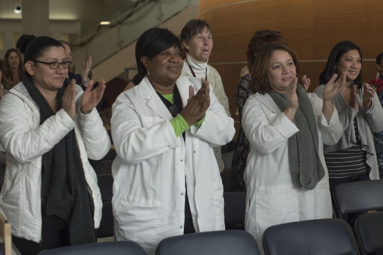 Audience members of the National Intrepid Center for Excellence Creative Arts Café give applause at the end of a performance at Walter Reed National Military Medical Center in Bethesda, Md., Dec. 13, 2016.  NCAC is performance platform for NICoE patients and staff to share creativity though creative arts once a month. (U.S. Air Force photo by Airman 1st Class Rustie Kramer)