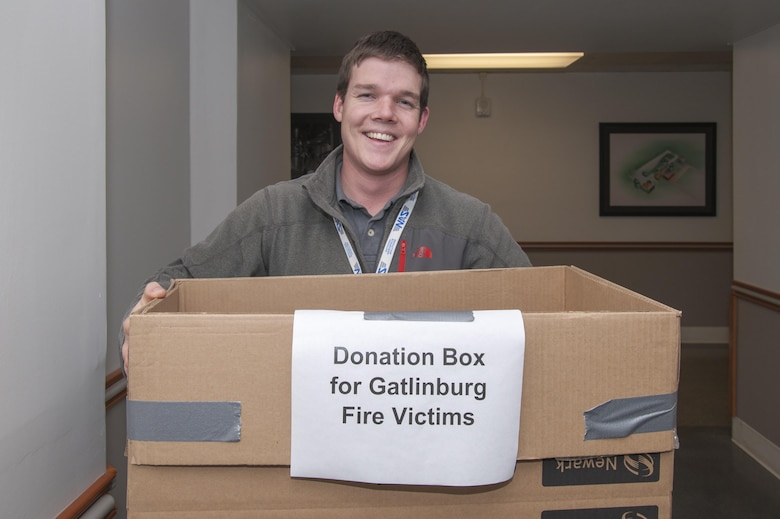 Kevin Brown, Propulsion Wind Tunnel mechanical system engineer, collects donations in the Administration and Engineering building at Arnold Engineering Development Complex Dec. 8 for Sevier County officials, in efforts to help the Gatlinburg fire victims. Donations requested include items such as baby supplies, personal hygiene, food, clothes, medicine and other miscellaneous items. Donations were delivered to the Sevier County University of Tennessee Extension Office Dec. 10. (U.S. Air Force photo/Jacqueline Cowan)