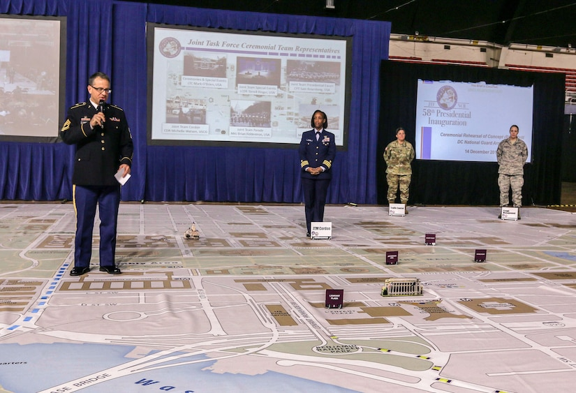 U.S. Army Master Sgt. Aaron Lovely, senior enlisted planner, Joint Task Force-National Capital Region, introduces the subject matter experts involved in inaugural planning and execution during the ceremonial rehearsal of concept drill at the D.C. National Guard Armory in Washington, D.C., Dec. 14, 2016. This final planning symposium showcased the culmination of months of preparation between military and civilian entities for the 58th presidential inauguration.