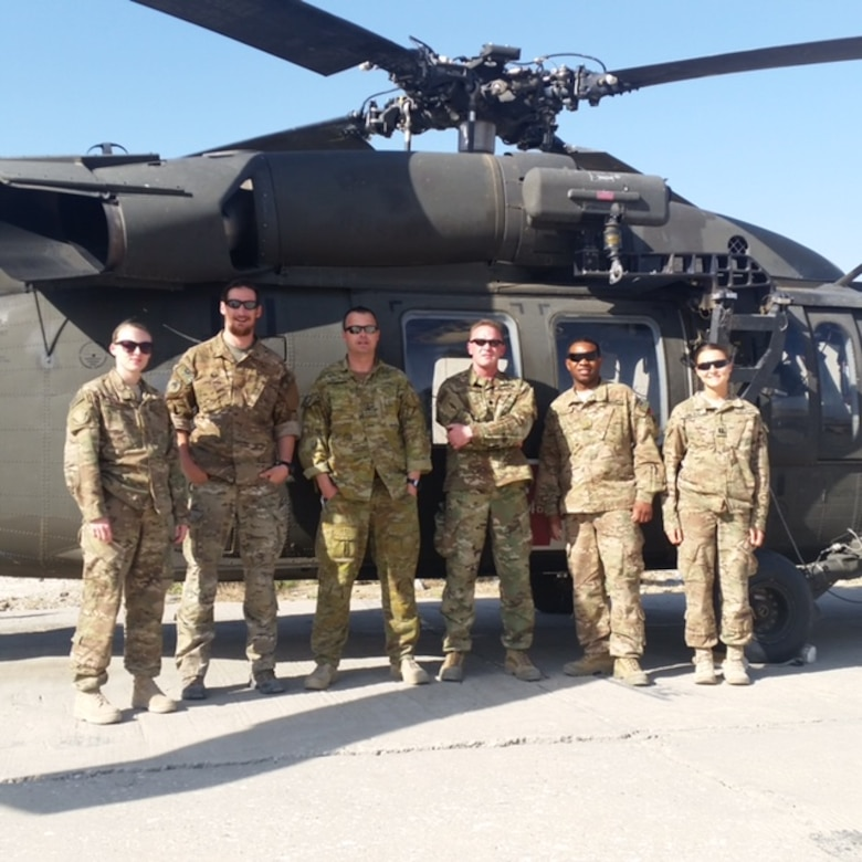Pictured here is Airman 1st Class Corynn Marcelo's team from the Camp Vance Aid Station she was assigned to. They are standing on the flight line in front of a Blackhawk medical evacuation helicopter. From left to right: Marcelo, medical logistician; Sgt. 1st Class Holger Mussbacher Austrian special operations medic; Warrant Officer 2 Matt Shoemaker, Australian senior medic; Lt. Col. Gerald Surrett, command surgeon; Maj. Samuel Lashley, medical planner; and Capt. Lindsay Umlauf, physical therapist.This is the team she was assigned to when she arrived which departed halfway through her deployment.