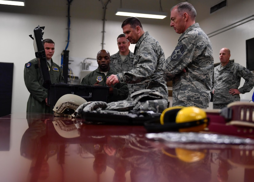 Tech. Sgt. Ray Livingston, 628th Security Forces Squadron phoenix raven, explains to Maj. Gen. Christopher J. Bence, U.S. Air Force Expeditionary Center commander, and Command Chief Master Sgt. Larry C. Williams, U.S. EC command chief, what kind of equipment the Ravens use Dec. 14, 2016. While at JB Charleston, Bence toured Team Charleston's facilities to get a first-hand look at joint operations.