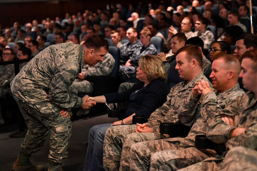 Maj. Gen. Christopher J. Bence, U.S. Air Force Expeditionary Center commander, greets members of Team Charleston during an All Call at the Base Theater here, Dec. 15, 2016. While at Joint Base Charleston, Bence toured Team Charleston's facilities to get a first-hand look at joint operations.
