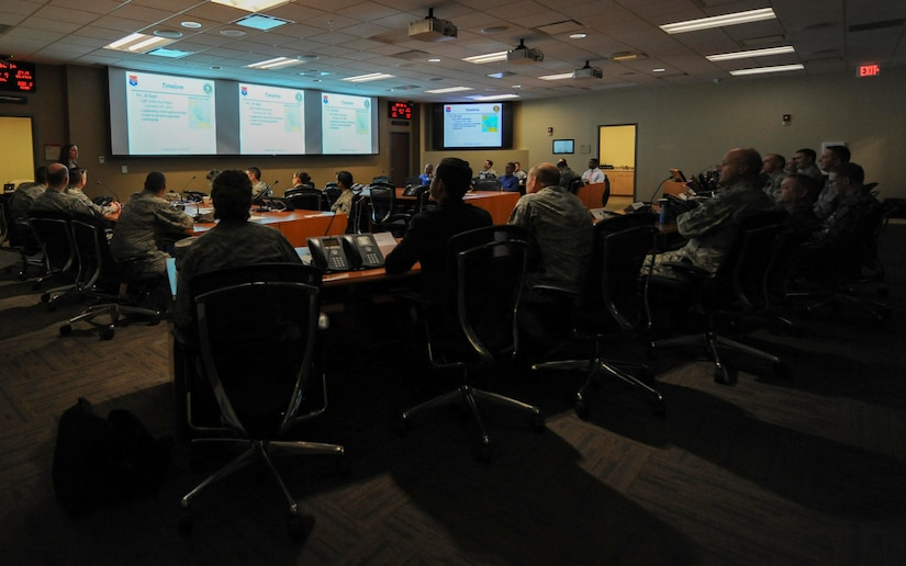Maj. Gen. Christopher J. Bence, U.S. Air Force Expeditionary Center commander, receives a briefing on the Joint Base Charleston ride-out team for Hurricane Matthew at the Emergency Operations Center here, Dec. 14, 2016. While at JB Charleston, Bence toured Team Charleston's facilities to get a first-hand look at joint operations.