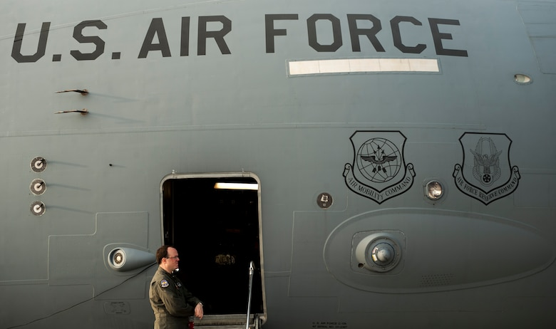 """Tech. Sgt. Mike Smith, loadmaster, stands by a C-17 Globemaster III prior to joint forcible entry exercise on Nellis Air Force Base, Nev., Dec. 10, 2016. JFEX is meant to challenge aircrews and ground combat units involved, and is an evaluation of the mission leadership's ability to efficiently integrate ground forces and dissimilar aircraft into one """"strike package."""" (U.S. Air Force photo by Airman 1st Class Kevin Tanenbaum)"""