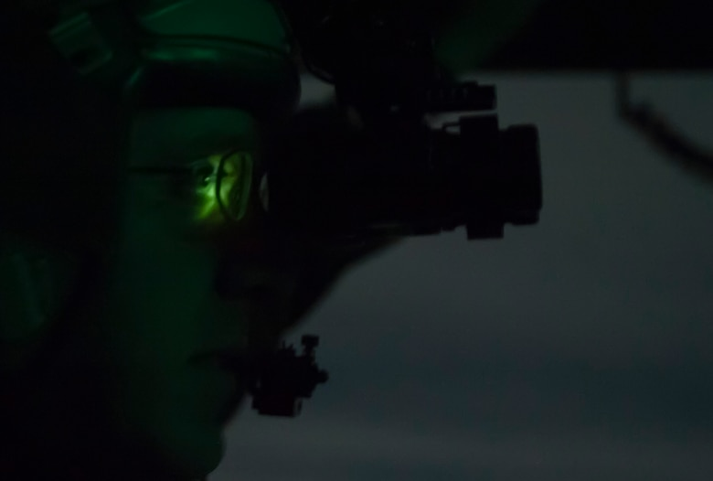 """Capt. Dan """"Filter"""" Naske, 57th Weapons Squadron pilot, uses night vision goggles to see while flying in a C-17 Globemaster III over the Nevada Test and Training Range on Dec. 10, 2016. The C-17 is operated by Air Mobility Command located at Travis Air Force Base, Calif.; Dover Air Force Base, Del.; Joint Base Lewis-McChord, Wash.; Joint Base Charleston, S.C., and Joint Base McGuire-Dix-Lakehurst, N.J. (U.S. Air Force photo by Airman 1st Class Kevin Tanenbaum)"""