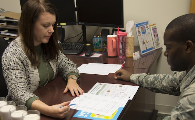 Sandra Stuart, 23d Medical Group health promotion dietitian, goes through an example meal plan with an Airman, Dec. 19, 2016, at Moody Air Force Base, Ga. Stuart provides individual sessions to personalize meal plans for individual goals. (U.S. Air Force photo by 2d Lt. Kaitlin Toner)