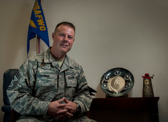 Command Chief Master Sgt. Charles R. Hoffman poses for a portrait in the United States Air Force Warfare Center on Nellis Air Force Base, Nev., Dec. 6, 2016. Hoffman recently took over as the new Command Chief of the USAFWC, coming from a diverse assignment background spanning Air Force and Army field units at the MAJCOM, group, squadron, brigade, and higher headquarter Army levels. (U. S. Air Force photo by Airman 1st Class Kevin Tanenbaum)