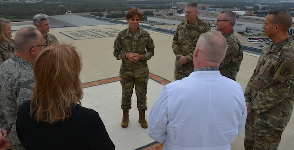 Lt. Gen. Nadja West, U.S. Army Surgeon General, talks with Army and Air Force doctors about Brooke Army Medical Center's trauma mission at Joint Base San Antonio-Fort Sam Houston Dec. 14 as they toured the only rooftop helipad in the Department of Defense.