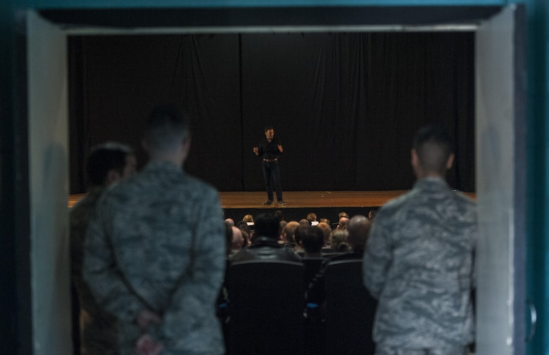 Airmen from the 57th Wing listen as Simon Sinek talks in the Base Theater of Nellis Air Force Base, Dec. 9, 2016. Sinek is an author, speaker, and consultant who writes on leadership and management. (U.S. Air Force Base by Airman 1st Class Kevin Tanenbaum/Released)