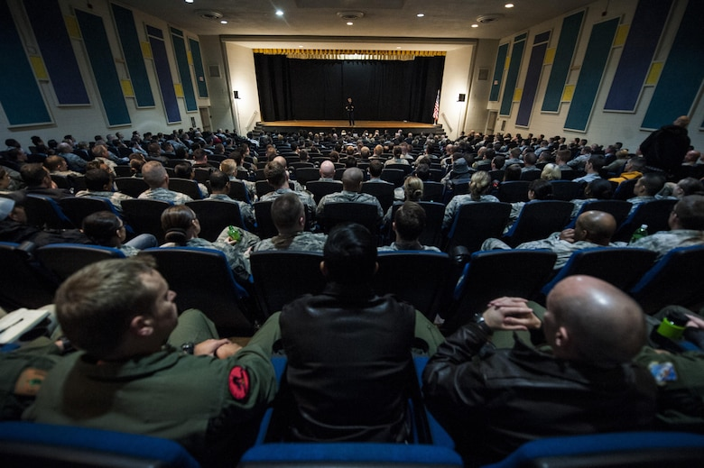 Simon Sinek speaks to members of the 57th Wing in the Base Theater of Nellis Air Force Base, Dec. 9, 2016. Sinek comes periodically to speak to the Airmen of Nellis AFB. (U.S. Air Force Base by Airman 1st Class Kevin Tanenbaum/Released)