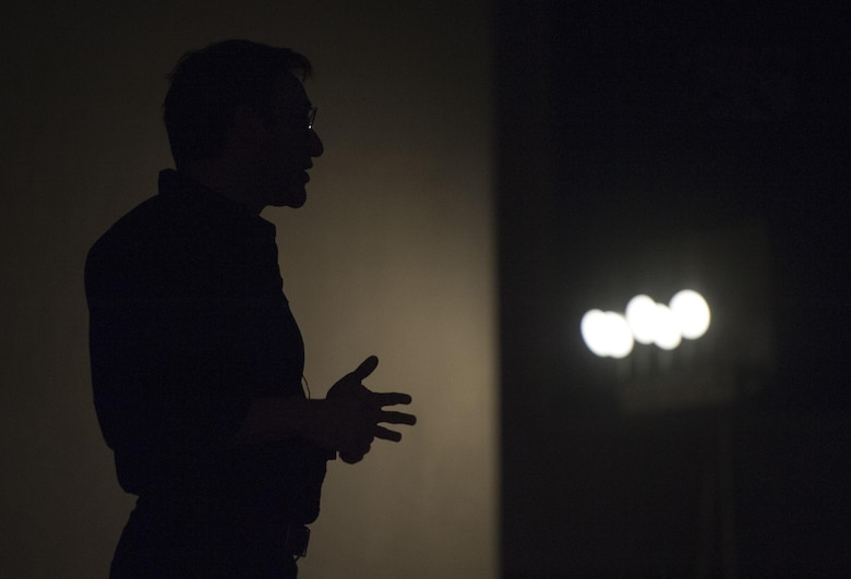 Simon Sinek speaks to Airmen in the Base Theater of Nellis Air Force Base, Dec. 9, 2016. Sinek is best known for popularizing the concept of The Golden Circle. (U.S. Air Force Base by Airman 1st Class Kevin Tanenbaum/Released)