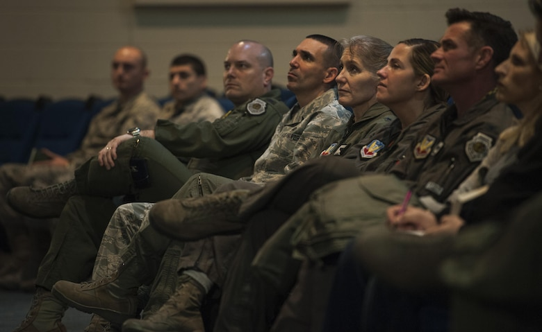 """Members of 57th Wing leadership listen to Simon Sinek as he gives a presentation in the Base Theater of Nellis Air Force Base, Dec. 9, 2016. Sinek's first TEDx Talk on """"How Great Leaders Inspire Action"""" is the 3rd most viewed video on TED.com. (U.S. Air Force Base by Airman 1st Class Kevin Tanenbaum/Released)"""