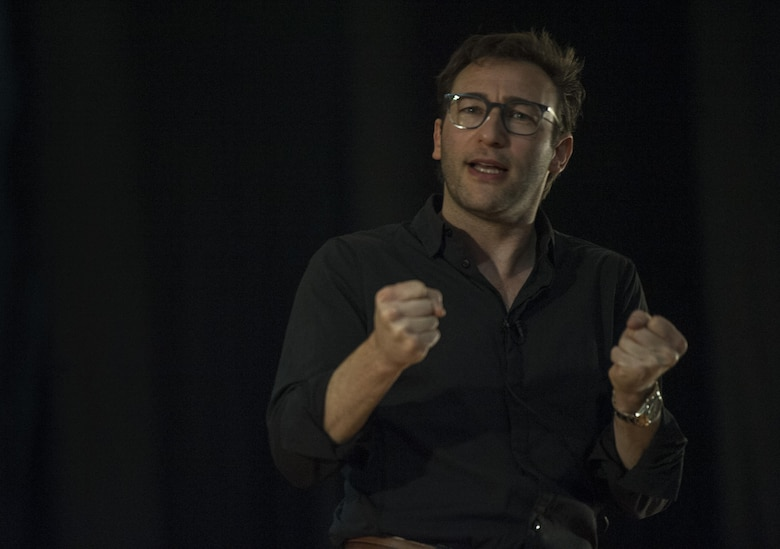 Simon Sinek gives a presentation to 57th Wing Airmen in the Base Theater of Nellis Air Force Base, Dec. 9, 2016. Sinek has been a commentator for The New York Times, Wall Street Journal, The Washington Post, Houston Chronicle, FastCompany, CMO Magazine, NPR, and BusinessWeek. (U.S. Air Force Base by Airman 1st Class Kevin Tanenbaum/Released)