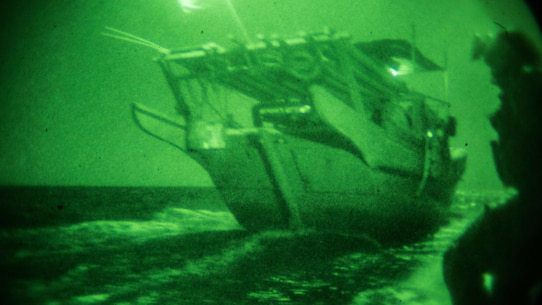 GULF OF ADEN (Dec. 12, 2016) U.S. Marines with the Maritime Raid Force, 11th Marine Expeditionary Unit (MEU), approach an unknown vessel from its stern to conduct a visit, board, search and seizure mission as part of Exercise Alligator Dagger, Dec. 12. Maritime security operations complement counterterrorism and security efforts of regional nations and seek to disrupt violent extremists' use of the maritime environment as a venue to launch attacks or to transport personnel, weapons or other material. Exercise Alligator Dagger, a U.S. 5th Fleet exercise, is a sustainment exercise enabling Makin Island Amphibious Ready Group and 11th MEU to rehearse complex amphibious operations that keep their skills ready for crisis response and contingency operations throughout the Central Command area of responsibility. (U.S. Marine Corps photo by Gunnery Sgt. Robert B. Brown Jr.)