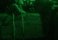 GULF OF ADEN (Dec. 12, 2016) U.S. Marines with the Maritime Raid Force (MRF), 11th Marine Expeditionary Unit (MEU), hook and climb a ladder on to an unknown vessel to conduct a visit, board, search and seizure (VBSS) mission during Exercise Alligator Dagger, Dec. 12. The MRF and special amphibious reconnaissance corpsmen provide the MEU with capabilities such as ship-borne and airborne raids, reconnaissance, and VBSS. The Makin Island Amphibious Ready Group and 11th MEU are operating in the U.S. 5th Fleet area of responsibility in support of maritime security operations and theater security cooperation efforts to ensure the free flow of commerce, freedom of navigation and regional security.  (U.S. Marine Corps photo by Gunnery Sgt. Robert B. Brown Jr.)