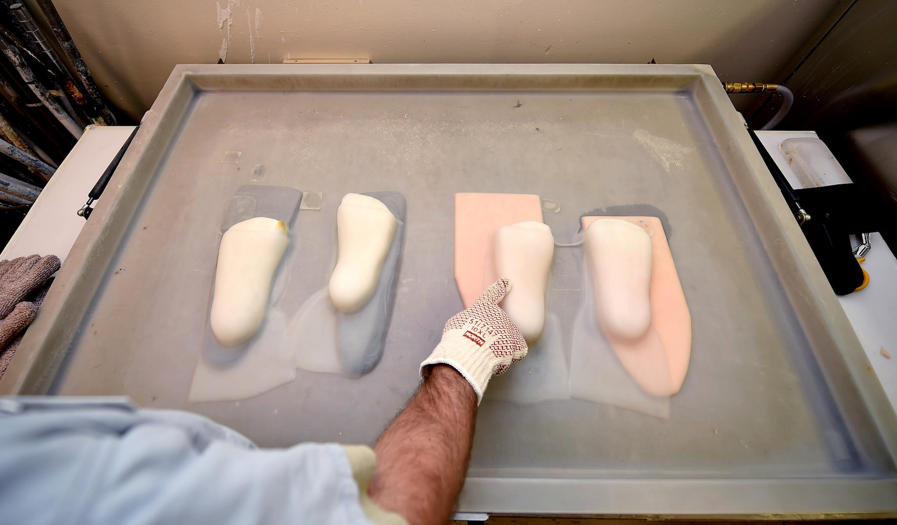 Staff Sgt. Devin Rudd, a student in the orthotics program, checks to see if the plastic for a foot orthoses has settled at the Wilford Hall Ambulatory Surgical Center, Joint Base San Antonio-Lackland, Texas, Aug. 24, 2016.(U.S. Air Force photo/Staff Sgt. Jerilyn Quintanilla)