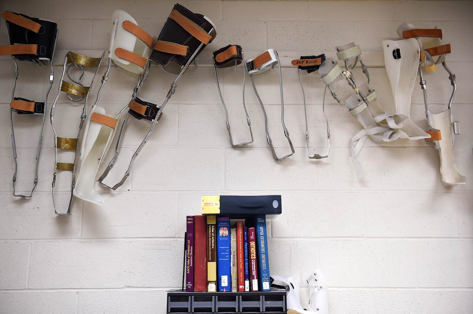 Leg braces created by former orthotics training students are displayed in the brace shop at the Wilford Hall Ambulatory Surgical Center, Joint Base San Antonio-Lackland, Texas, Aug. 24, 2016.(U.S. Air Force photo/Staff Sgt. Jerilyn Quintanilla)