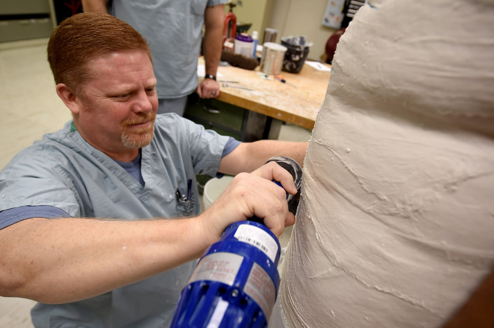 Lawrence New, a 59th Medical Wing orthotist and orthotics instructor, cuts through a plaster mold at the Wilford Hall Ambulatory Surgical Center, Joint Base San Antonio-Lackland, Texas, Aug. 24, 2016. (U.S. Air Force photo/Staff Sgt. Jerilyn Quintanilla)