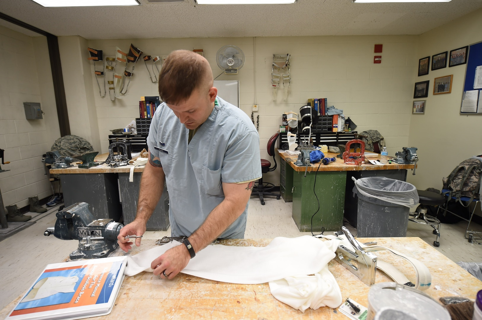 Staff Sgt. Devin Rudd, a student in the orthotics program, measures plaster cloth to make a body jacket orthoses at the Wilford Hall Ambulatory Surgical Center, Joint Base San Antonio-Lackland, Texas, Aug. 24, 2016. (U.S. Air Force photo/Staff Sgt. Jerilyn Quintanilla)
