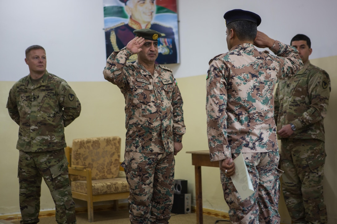 AMMAN (December 15, 2016) -- A Jordanian Armed Forces Non-Commissioned Officer receives his diploma after graduating from the Jordan Basic Instructor Course. The two-week long course, which features instruction from U.S. Army NCO's, is designed to enhance the leadership abilities of the JAF's enlisted leaders. (U.S. Central Command photo by Marine Sgt. Jordan Belser)