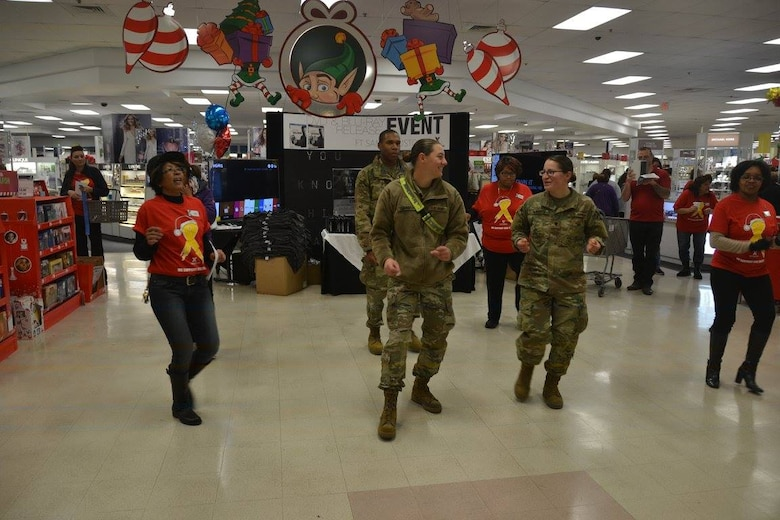 The Exchange at Joint Base San Antonio-Fort Sam Houston opened early Dec. 10 to give Soldiers, Airmen and Sailors studying at the Medical Education and Training Campus the chance to buy, wrap and ship holiday gifts to friends and family during the AIT Holiday Shopping Event. Service members also cut loose on the dance floor, won prizes and took photos with Santa.