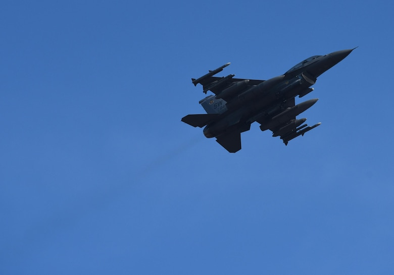 A U.S. Air Force F-16CM Fighting Falcon from the 20th Fighter Wing, Shaw Air Force Base, S.C., flies above the flightline at Tyndall Air Force Base, Fla., Dec. 16, 2016. Shaw AFB sent 16 F-16s and approximately 140 Airmen to participate in the Checkered Flag 17-1 and Combat Archer 17-3, a large-scale, aerial total force integration exercise. (U.S. Air Force photo by Staff Sgt. Alex Fox Echols III/Released)