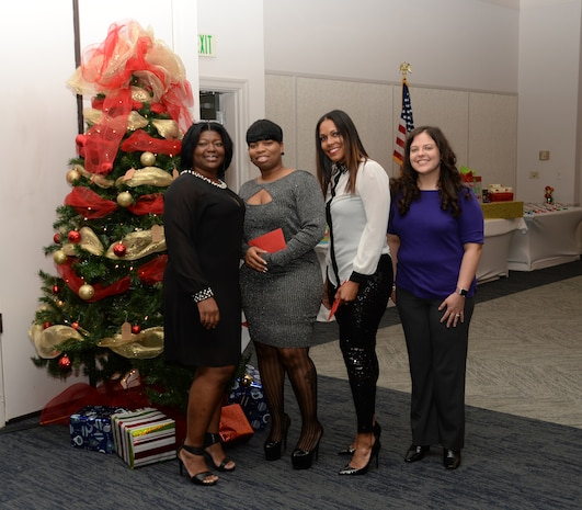 Active-duty Sailors and civilian personnel at Naval Branch Health Clinic-Albany, aboard Marine Corps Logistics Base Albany, kick off the holiday season at the Hilton Garden Inn, Albany, Ga., Dec. 15. Clinic personnel (left to right) Shebreaka Clyde, clinical nurse; Clarissa Bryant, executive assistant, and Petty Officer 2nd Class Chloee Ward partnered with Lt. Amy Starling, senior nurse executive/interim officer-in-charge, NBHC-Albany, to coordinate the annual event.