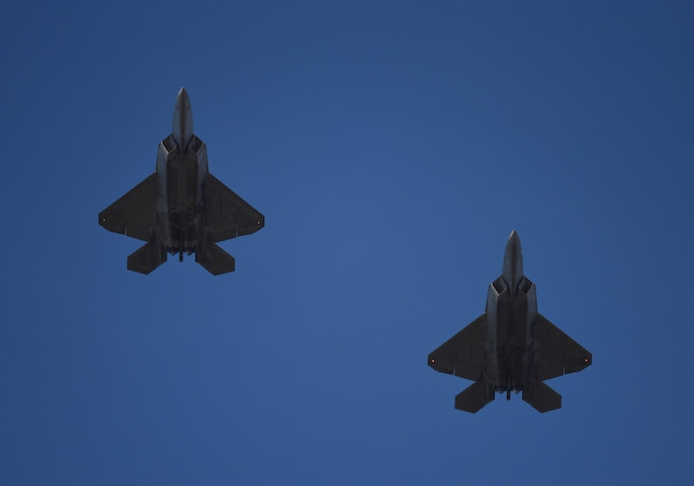 Two U.S. Air Force F-22 Raptors from Tyndall Air Force Base, Fla., fly in formation during Checkered Flag 17-1, Dec. 16, 2016. The integration training pilots receive during exercises like Checkered Flag ensure teams of different capabilities can seamlessly integrate and work together in a real-world combat situation utilizing fifth- and fourth-generation air assets. (U.S. Air Force photo by Staff Sgt. Alex Fox Echols III/Released)