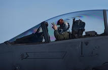 A U.S. Air Force F-15E Strike Eagle pilot from Mountain Home Air Force Base, Idaho, signals as he taxies down the flightline during Checkered Flag 17-1 at Tyndall Air Force Base, Fla., Dec. 16, 2016. More than 300 Airmen from Mountain Home AFB deployed along with 16 F-15E Strike Eagles to participate in the large-force exercise, integrating with other fourth-generation aircraft as well as the F-22 Raptor and the F-35 Lightning II. (U.S. Air Force photo by Staff Sergeant Alex Fox Echols III/Released)