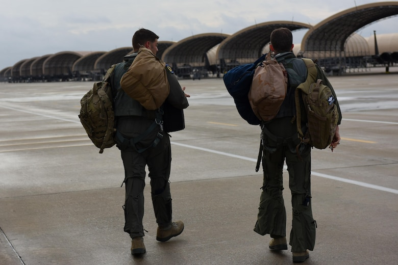 Col. Christopher Sage (right), 4th Fighter Wing commander, and Maj. Brian Privette (left), 4th Fighter Wing executive officer, walk to their aircraft, Nov. 30, 2016, at Seymour Johnson Air Force Base, North Carolina. Seymour Johnson has more than 90 F-15E Strike Eagle aircraft assigned to two operational and two training fighter squadrons that go to a programmed depot maintenance at Robins Air Force Base, Georgia, approximately every three years. (U.S. Air Force photo by Airman Miranda A. Loera)