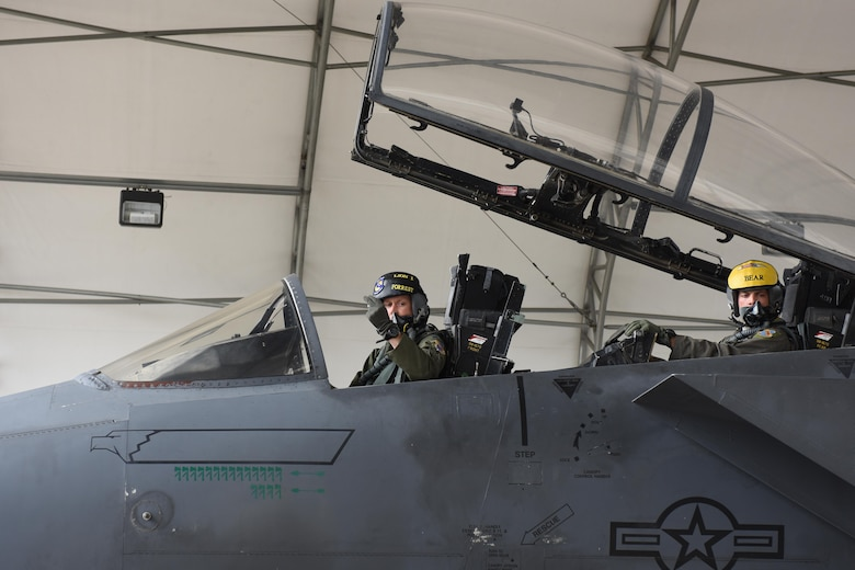 Col. Christopher Sage (left), 4th Fighter Wing commander, and Maj. Brian Privette (right), 4th Fighter Wing executive officer, prepare to take off for Robins Air Force Base, Georgia, Nov. 30, 2016, at Seymour Johnson Air Force Base, North Carolina. Sage flew an F-15E Strike Eagle to Robins AFB for a programmed depot maintenance. (U.S. Air Force photo by Airman Miranda A. Loera)