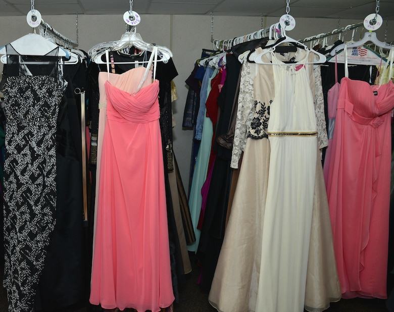 Dresses hang at the Operation Deploy Your Dress boutique, a non-profit organization led by military spouses located at Joint Base Langley-Eustis, Va., Dec. 20, 2016. ODYD provides free gently-used or new formal attire to military families to help reduce the cost of attending formal military events. (U.S. Air Force photo by Airman 1st Class Tristan Biese)