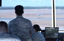 U.S. Air Force air traffic controllers from the 325th Operations Support Squadron at Tyndall Air Force Base, Fla., track an F-22 Raptor as it takes off on the Tyndall AFB flightline during Checkered Flag 17-1 Dec. 12, 2016. Tyndall's air traffic controllers were responsible for an additional 40 aircraft during concurrent exercises Checkered Flag 17-1 and Combat Archer 17-3. (U.S. Air Force photo by Senior Airman Solomon Cook/Released)