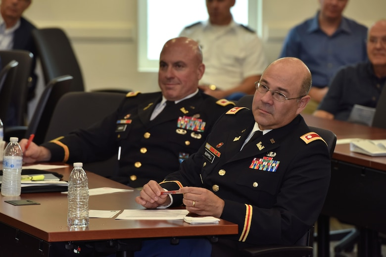 United States Army Corps of Engineers Mobile District Deputy Commander for Latin America, Lt. Col. Humberto Boppell, listens as Col. James DeLapp, Mobile District commander honors him during a retirement ceremony Dec. 16 at the Conference Center of America's in Miami, Fla. Boppell retired after 27 years of distinguished service to the nation. (Photo by Tim Oberle, USACE Mobile Public Affairs)