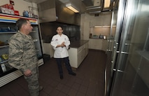 Senior Airman Alexandra Ayub, 90th Force Support Squadron missile chef, explains her job to Air Force Chief of Staff Gen. David L. Goldfein during a familiarization tour at a missile alert facility in the 90th Missile Wing missile complex, Dec. 19, 2016. Ayub is responsible for cooking for all personnel at the missile alert facility. (U.S. Air Force photo by Staff Sgt. Christopher Ruano)