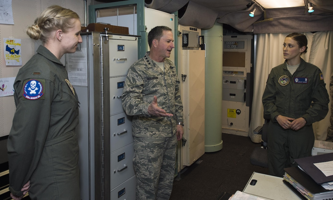 """Air Force Chief of Staff Gen. David L. Goldfein receives a tour of the launch control center from 1st. Lt. Ashley Mirsky, 319th Missile Squadron missile combat crew commander, and 2nd Lt. Marie Blair, 319th MS deputy missile combat crew commander, during a familiarization tour at a missile alert facility in the 90th Missile Wing missile complex, Dec. 19, 2016.  When directed by the U.S. President, a properly conducted key turn sends a """"launch vote"""" to any number of Minuteman III ICBMs in a missileer's squadron. Two different launch votes are required to enable a launch. (U.S. Air Force photo by Staff Sgt. Christopher Ruano)"""