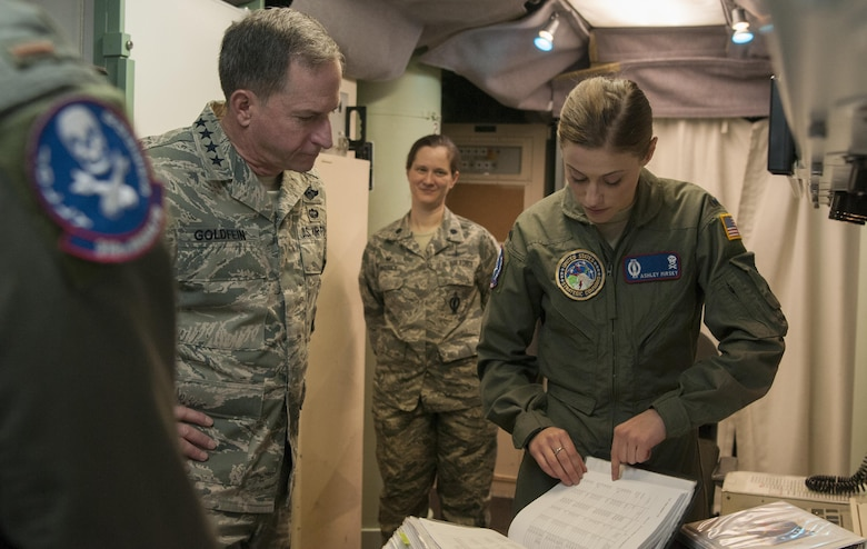 First Lt. Ashley Mirsky, 319th Missile Squadron missile combat crew commander explains how all launch control centers communicate with one another to Air Force Chief of Staff Gen. David L. Goldfein during a familiarization tour at a missile alert facility in the 90th Missile Wing missile complex, Dec. 19, 2016. The 90th MW contributes to the nation's strategic defense by sustaining and operating 150 Minuteman III ICBMs and the associated launch facilities which cover 9,600 square miles across three states. (U.S. Air Force photo by Staff Sgt. Christopher Ruano)